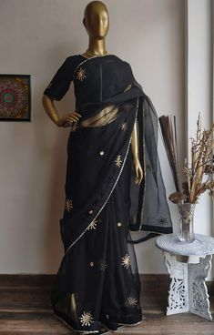 Featuring this beautiful Black saree in Organza base with hand embroidered gota patti bootis all over. It is paired with a Black Dupion blouse with Gota Patti Work on Front, back and sleeves.  ... www.labelkanupriya.com ... #organzasaree #designersaree #floral #designerblouse Traditional Sarees, Traditional Outfits, Gota Patti Saree, Sari Dress, Organza Saree, Saree Models, Black Saree, Saree Look, Party Wear Sarees