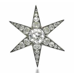 AN ANTIQUE DIAMOND BROOCH   Designed as a star set with old-cut diamonds, mounted in silver and gold, 19th Century, 3.7 cm