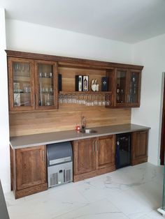 Solid oak display cabinet with jax oleum finish. Kühn Houtwerke is situated in the Boland, Cape Winelands area. We specialize in kitchen cupboards, bedroom cupboards, solid woodworking, custom furniture and much more. For a quotation please send an email to khoutwerke@icon.co.za and we will be happy to assist. Follow us on Pinterest for our latest pins. Bedroom Cupboards, Kitchen Cupboards, Oak Display Cabinet, Wine Cellars, Bar Counter, Custom Furniture, Solid Oak, Quotation, Cape