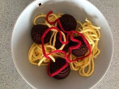 Crochet food. Meatballs (absolutely horse meat free), pasta and ketchup.