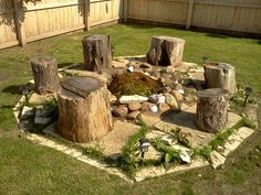 Homemade fire pit from rocks and tree stumps for stools.