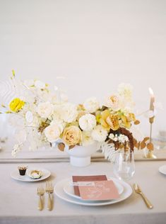 Lunaria wedding inspiration is the name of the game for this Prospect House elopement story. With a honey velvet backdrop, modern minimalist tablescape and rice paper wafer cake, this creative team didnt skip a beat! The bride stuns in an off-the-shoulder wedding dress with swooped sleeves. And the groom? 10/10 in a rust colored suit we cannot get enogh of. See this bright, cheery wedding inspiration in full on Ruffled now! #floralchandelier #autumnwedding #velvetdecor