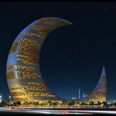 Crescent Moon Tower in Dubai. Beautiful the way the lights shine through.