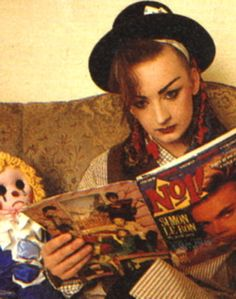 Boy George. I love this scene.  Except the doll is pretty creepy.