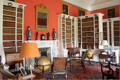 I like this library at Belton House in England. The bright walls are so great against the white bookshelves.