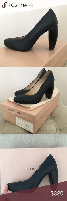 Sydney Brown Vegan Cork & Wood Pumps - NIB New in box w/ dust bag, never worn!   Luxe vegan pumps, sustainably made in Los Angeles. Indigo cork upper (very dark blue, almost black) and black wood heel.   Size: 37 (runs 1/2 size small, I am a 6)   Bonded cork upper & synthetic liner derived from recycled plastic bottles. Cork covered recycled-fiber insole. Sustainably harvested PEFC-certified German beech wood heel. Natural rubber sole. Naturally occurring variations in the wood are expected…