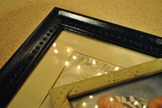 EASY way to dress up a plain or cheap frame.    Puffy Fabric Glue (dots or lines or any pattern)   then Spray paint frame.
