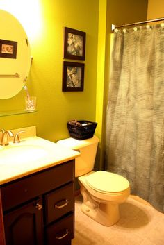basket above the toilet and shelf between mirror and sink
