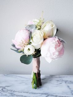 blush peony, roses and white ranunculus bridal bouquet