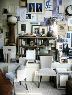 {Thomas O'Brien's Bulletin Board Coexists with Books and an assortment of Objets d'Art.}