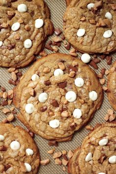 Giant thick and chewy brown butter cookies are stuffed with milk chocolate toffee and white chocolate chips!