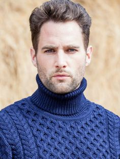 Men's Wool Turtleneck Sweater in Navy made of 100% soft Merino Wool. Features traditional honeycomb stitching.