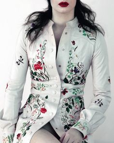 Embroidered white leather coat by Louis Vuitton