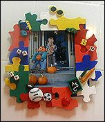 Waste Not Picture Frame Lesson Plan - Crafts for Kids - KinderArt glue puzzle pieces to create a picture frame. Paint and add embelishments.
