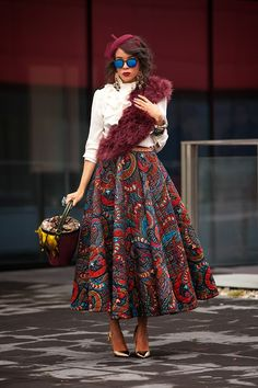 Cutest and most creative outfit I have seen in a long while - fur sash, beret, and African-inspired pattern skirt in garnet red. African Inspired Fashion, African Dresses For Women, African Print Fashion, African Wear, African Attire, African Women, Fashion Prints, African Prints, African Style