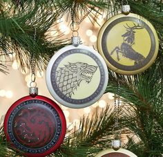 Each Game of Thrones ornament features its House sigil. House Targaryen – three headed dragon; House Lannister – lion; and House Stark – the grey direwolf.