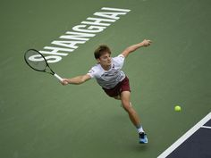David Goffin Photos Photos - David Goffin of Belgium returns a shot to Benoit Paire of France in the men's singles third round match during Day 4 of the ATP Shanghai Rolex Masters 2016 at Qi Zhong Tennis Centre on October 12, 2016 in Shanghai, China. - ATP Shanghai Rolex Masters 2016 - Day 4