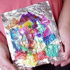 Tissue paper/glitter/glue collage on tin foil, cut out shapes to make holiday/Valentine's cards or ornaments.