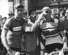 Norman Wisdom helps Syd Wilson fuel up before the 1958 Tour of Britain, the Milk Race. Norman Wisdom, Tour Of Britain, Sid Wilson, Vintage Cycles, Iconic Photos, Comedians, Victorious, Captain Hat, Champion