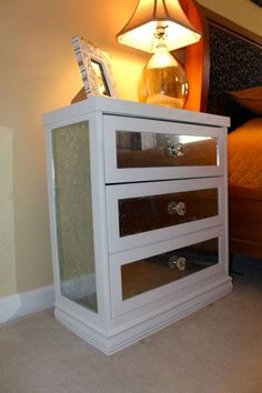 DIY Mirrored Nightstand. Decorate the IKEA Rast 3 drawer chest with some mirrors for a chic side table in your bedroom. See more details