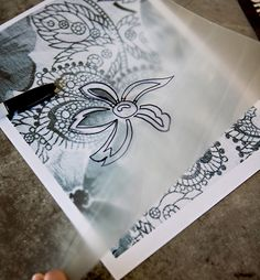 make your own stencil. Good tip about using spray adhesive so it doesn't leave residue.