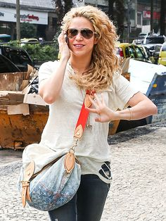 We just love Shakira's gorgeous curly blonde locks, not to mention her chic gold-rimmed aviators…a sunwear style that can pull any casual look together!