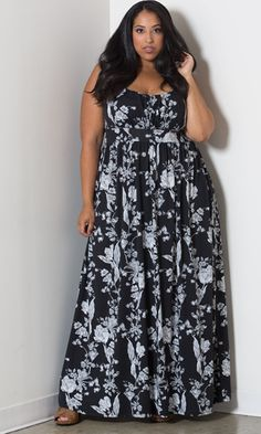 A beautiful black and white floral print maxi with a ruched bust line. Features Empire waist, scoop neck and ruched fabric. Pair with a colorful scarf and strappy sandals for a classic look.