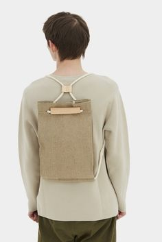 Read about Design & Production Pocket bag can be worn as a sack or as a shoulder bag. To transform it, simply pull the string. It features a 100% linen lini