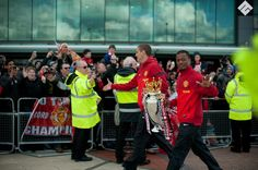 Captured captains #Evra #Vidic carrying #Premiership trophy outside #OldTrafford before boarding the open top bus parade of #Manchester