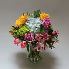 WATERCOLOR:  A soft yet colorful mix of Roses, Hydrangea, Gerbera Daisies and Alstroemeria designed in a clear glass vase.  #MatlackFlorist