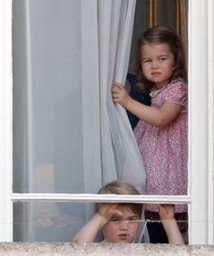 Prince George of Cambridge and Princess Charlotte of Cambridge watch from a window of Buckingham Palace during the annual Trooping the Colour Parade on June 17, 2017 in London, England. via @AOL_Lifestyle Read more: https://www.aol.com/article/lifestyle/2017/06/17/prince-george-charlotte-balcony-trooping-colour/22417807/