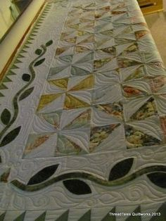 Quilt - pinwheels make such pleasing compositions, and the applique border really sets this off