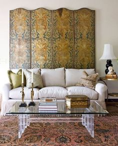 This Nashville living room is filled with rich fabrics and classic decor. - Traditional Home ® / Photo: Reid Rolls / Design: Roger Higgins and Ann Shipp