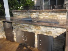 Outdoor Kitchen with bar top veneered in East West Stone - Honey Gold - Granite Countertop - Flanders, NY