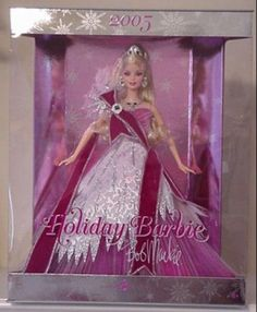 Release date: 6/1/2006 product code:J0949 The 2006 Holiday™ Barbie® by Bob Mackie is wonderfully sophisticated in a black gown and white faux fur, embellished with festive multicolored stars. Description from pinterest.com. I searched for this on bing.com/images