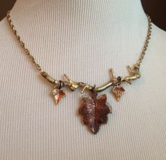 Handmade brass tree branch and maple leaf necklace