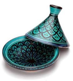 This one totally goes to my `Wish List`... Such an awesome design! (Tagine, for my moroccan recipes)