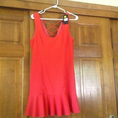 Super Cute Flirty Dress! Very cute dress, size large, in a beautiful coral color.  Would go great with a beautiful tan! Very J Dresses