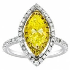 Marquise Cut White & Yellow Gold Diamond Engagement Ring - One of the most astonishing pieces we've ever reviewed is this Marquise Cut White & Yellow Gold Diamond Engagement Ring featuring a 18k White Gold Marquise Yellow gemstone placed in a Prong setting with White Round cut accent stones on the shank & Halo style mount. The Marquise White & Yellow engagement ring comes with a VS2 in clarity & the total gem weight is equal to 3.05 carats. The diamonds are 100% natural. #unusualengagementrings