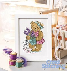 Sweet cross stitch teddy bear pattern. Celebrate a loved one, whether friend or family, with this gift of a charming design – a great beginner project! Find the pattern only in the new issue 227 of The World of Cross Stitching magazine