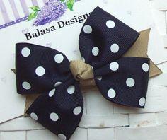 Boutique Navy Dot and Khaki School Uniform Hair Bow. $2.50, via Etsy.