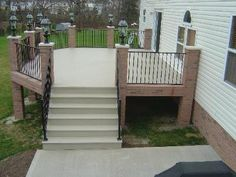 Azek deck with Fortress Iron rail and brick pillars in Cranberry