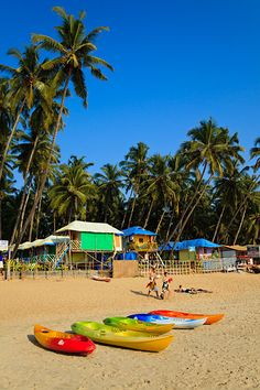 Kayaks for rent in front of the souvenir stalls, wooden bungalows and restaurants which line the beach in Palolem, located in Southern Goa. Goa India, Canoe And Kayak, Travel Set, Group Tours, Beach Holiday, Photography Portfolio, Travel Photographer, Incredible India, Kayaking