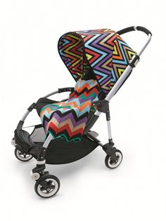 The luxury stroller company, Bugaboo will release beautiful Missoni prints in July. While a bright block print embellishes the Bugaboo Cameleon sun cover, the vivacious zigzags beautifies the Bugaboo Bee sun canopy. Missoni, Bugaboo Bee Stroller, Baby Strollers, Chevron, Babyshower, Baby Carriage, Stylish Baby, Baby Gear, Future Baby