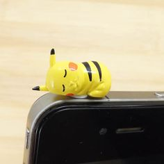 Kawaii Sleeping Pikachu Pokemon Dust Plug 3.5mm Smart Phone Dust Stopper Earphone Cap Dustproof Plug Charms for iPhone 4 4S 5 HTC Samsung. $3.99, via Etsy.