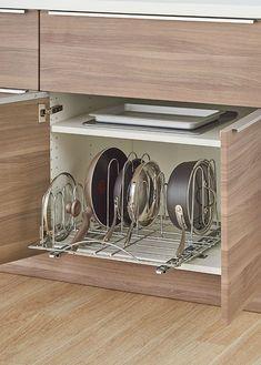 12 ingenious ways to organize your kitchen - Sliding pot organizer