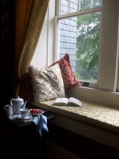 Do you love rainy days, tea time, good books, window seats, cozy pillows...so do I! Here's one of my favorite nooks in my home for quiet moments. #windowseat #teatime #goodbook #tea #recipes #pillows #cozycottage #reading #teaset