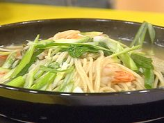 Food Network invites you to try this Spicy Shrimp and Bok Choy Noodle Bowl recipe from Rachael Ray.