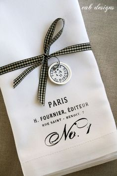 Classy simplicity linens, monogram, stamp, screen print, stamp, houndstooth/plaid ribbon, tags