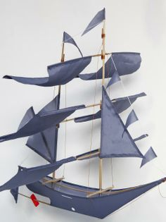 Denim kite, with Gray Label logo on one side, in the form of a pirate ship, made in Indonesia by father Mâdé and his 2 sons.